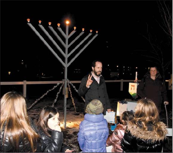 Menorah Lighting at Camuso Display