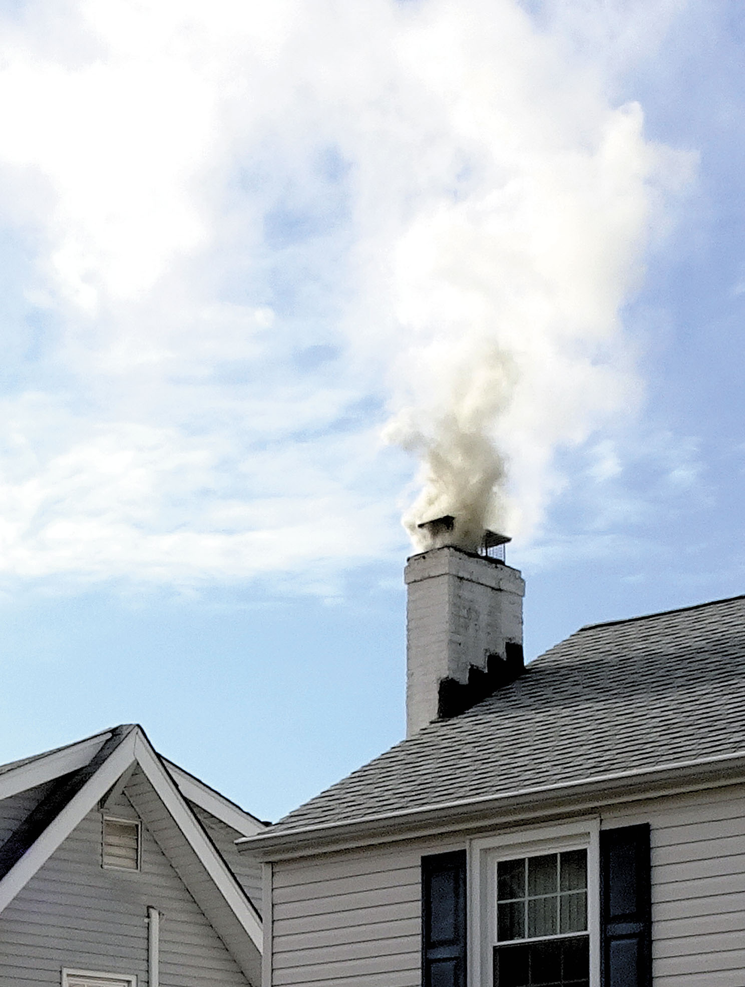 Firefighters extinguish chimney fire put out brush fire - Put out fire in fireplace ...